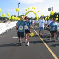 Sandy Coull walking with her brother Les (left) across the finish line at the 2008 LiveStrong event in Philadelphia.