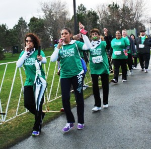Team of people march for Wellspring